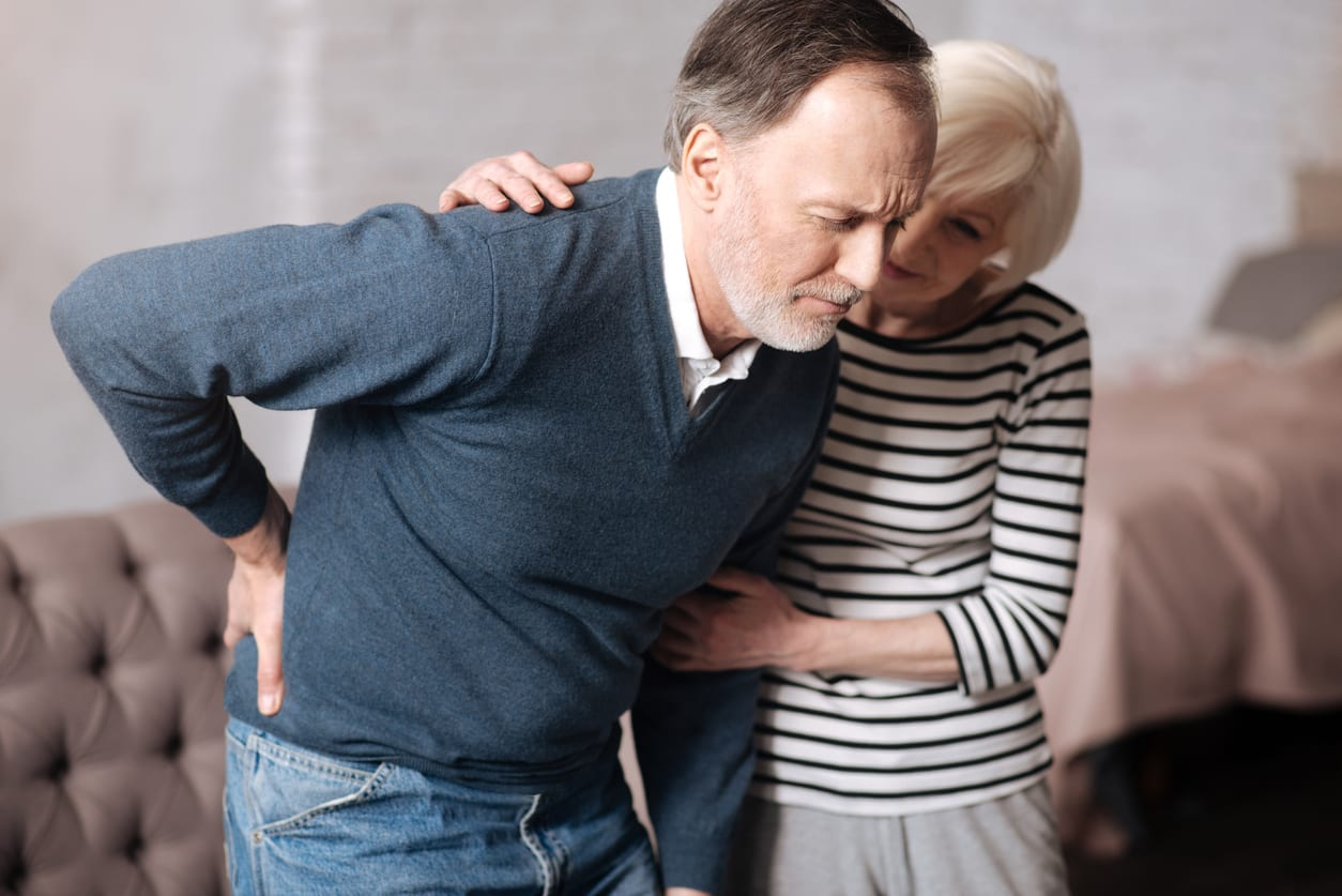 Free Postural assessment Senior man with terrible backache with wife